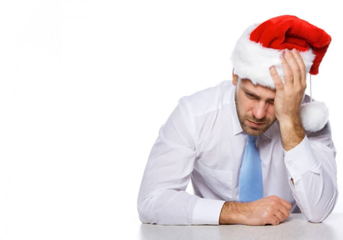 Image of tired employee with christmas hat